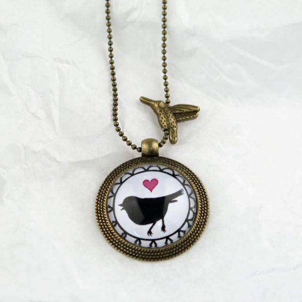 Medaillon-Halskette Herz Vogel