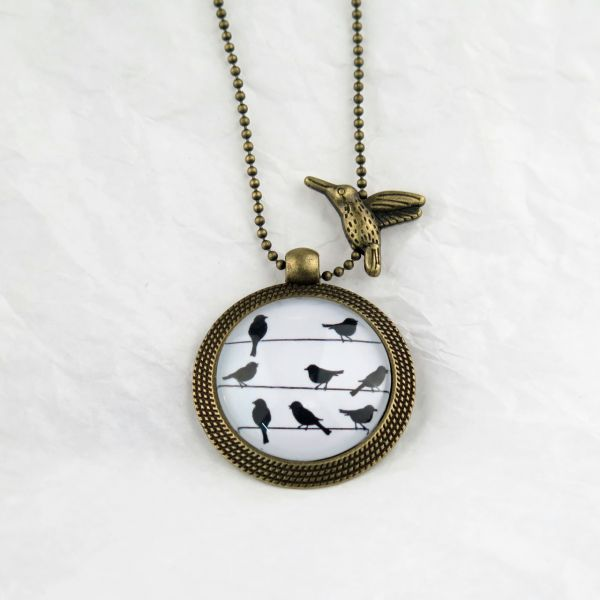 Medaillon-Halskette Vogel auf dem Drahtseil