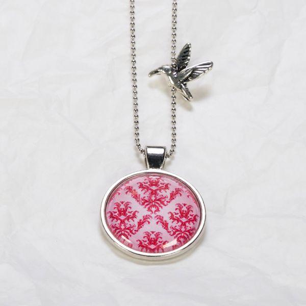 Medaillon-Halskette Magenta Blumen auf Pink